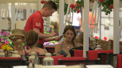 View of a waiter and customers at a restaurant in Warsaw Stock Footage