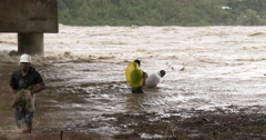 Fishermen Tackle Raging Flood Waters In River - stock footage