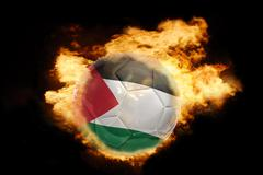 football ball with the flag of jordan on fire - stock photo