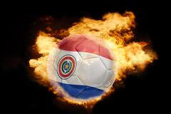football ball with the flag of paraguay on fire - stock photo