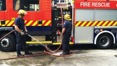 Firefighters in Auckland City Fire Station in Auckland New Zealand Stock Footage