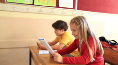 Elemantary students in classroom - stock footage