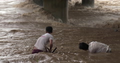 Fishermen Tackle Raging Flood Waters In River close up Stock Footage