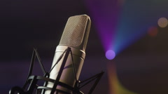 Mic - Microphone On Stage w/ Bokeh, Lasers & Disco Lights in Background Stock Footage