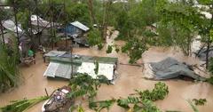 River Floods Slum Houses Hurricane Aftermath Stock Footage