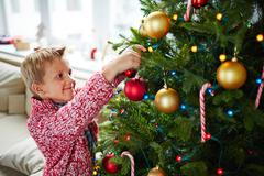 Decorating firtree with bubbles Stock Photos