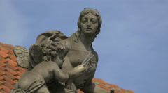 Statues decorating the roof of a building in Warsaw Stock Footage