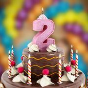 Birthday cake with number 2 lit candle - stock illustration