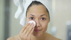 4K Close up portrait woman in bathroom going through skin care routine  - stock footage