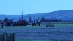 Tractors working on a farm. - stock footage