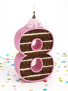 Number 8 shaped chocolate birthday cake with lit candle - stock illustration