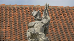 Old statue on the roof of a building in Warsaw Stock Footage