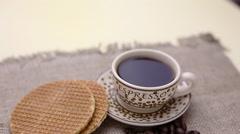 Dutch stroopwafel, caramel waffle and coffee Stock Footage