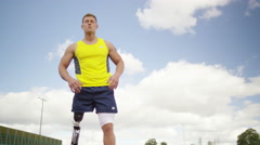 4K Disabled athlete with prosthetic leg at running track - stock footage