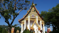Buddhist wat Temple building with garden at dusk Stock Footage