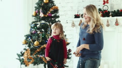 Family decorating the Christmas tree - stock footage