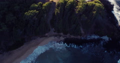Aerial Flight Over White Sandy Beach and Beautiful Blue Ocean. Amazing Sunris Stock Footage
