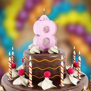 Birthday cake with number 8 lit candle - stock illustration