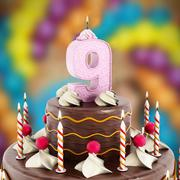 Birthday cake with number 9 lit candle - stock illustration