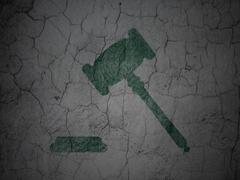 Stock Illustration of Law concept: Gavel on grunge wall background