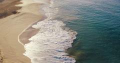 Aerial Flight Over White Sandy Beach and Beautiful Blue Ocean. Amazing Sunris Stock Footage
