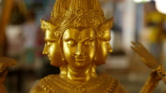 Golden Buddhist Statue - Azura slow motion closeup Stock Footage