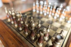 Aligned chess pieces - stock photo