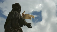 Priest statue on Charles Bridge in Prague - stock footage