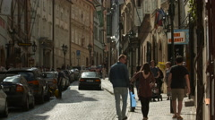 Adults and babies on Nerudova Street in Prague Stock Footage