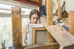 Female painter working in studio Stock Photos