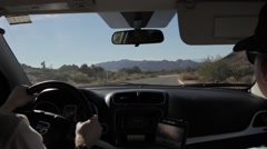 Couple driving through the desert Stock Footage