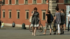 Riding bikes in Castle Square, Warsaw Stock Footage