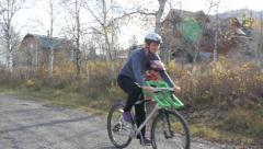 Mom and baby on a bike ride Stock Footage