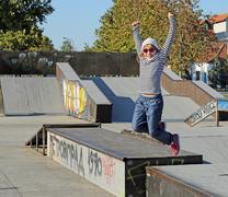 Happy little girl jumping in skate park Stock Photos