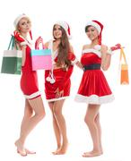 Shopping, sale, gifts, christmas, x-mas concept - smiling female in red costu Stock Photos