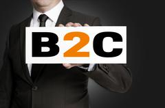 b2c shield of businessman held concept - stock photo