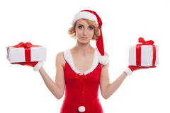 Christmas, x-mas, winter, happiness concept - smiling blonde woman in santa h Stock Photos