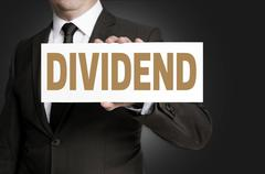 dividend sign is held by businessman concept - stock photo