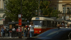 Red tram stopped on the street in Prague Stock Footage