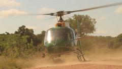 SANParks Helicopter lifting off INSIDE KRUGER - RARE shot Stock Footage