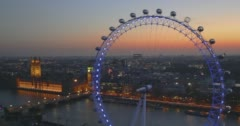 London Eye and Houses of Parliament in London at dusk-v2 Stock Footage
