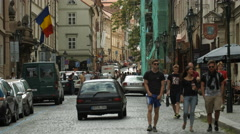Driving cars and walking near the Romanian Embassy building in Prague Stock Footage
