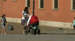 Woman with baby stroller walking in Castle Square, Warsaw - stock footage