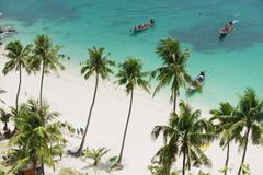 Stock Photo of Tourists arrive to the beach, Koh Samui, Thailand.