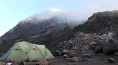 Mount Kilimanjaro is covered by clouds. View from the camp - stock footage