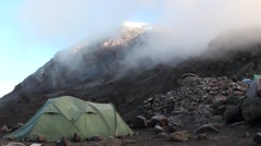 Mount Kilimanjaro is covered by clouds (time lapse). View from the camp Arkistovideo