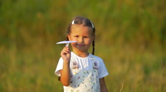 The small girl hold and launch paper airplane. Slow motion capture Stock Footage