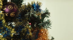 Little girl hangs on a Christmas tree ball Stock Footage