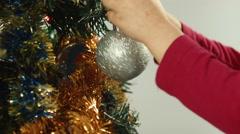 Little girl hangs on a Christmas tree ball Stock Footage