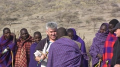 A group of masai tribesmen and a tourist. Tanzania Stock Footage